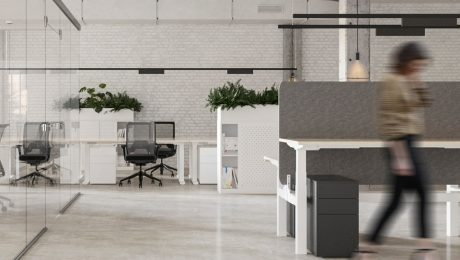 Modern office interior with height adjustable desk