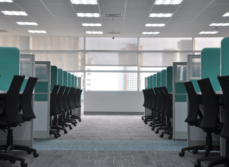 An empty workspace with chairs and desks